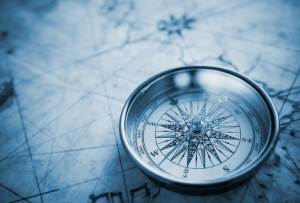 picture of a compass sitting on a map