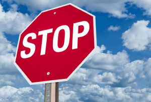 Picture of a red stop sign against a blue sky